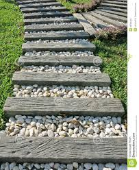 Small Rocks For Garden Wood And Small White Rocks Pathway On Grass In The Garden Stock