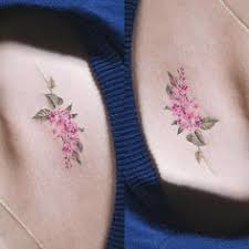 watercolor style lilac on the ankle tattoo artist sol tattoo