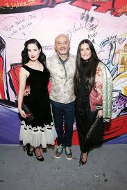 the red heels are coming christian louboutin celebrates a new