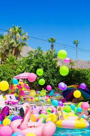 an epic rainbow balloon pool party studio diy