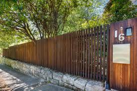 timber batten front entry fence formed gardens fence details