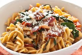 pasta with sweet potatoes tomatoes garlicky kale and bacon