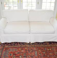 Loveseat Slipcovers With Two Cushions An Arhaus Two Cushion Sofa With White Canvas Slipcover Ebth