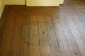 water stains from pot plants to the wood floor timber and lime