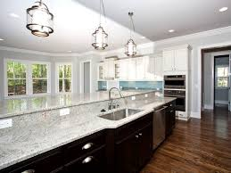 Black Cabinets Kitchen Black Cabinets Light Granite Countertops And A Blue Glass Back