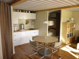 kitchen with temporary plumbing tin can cabin
