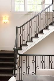 Banister And Spindles Staircase With Iron Circles Spindles Transitional Entrance Foyer