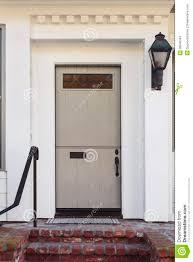 Front Door Light Fixtures by Taupe Front Door Of Modern Home Stock Photo Image 38940343