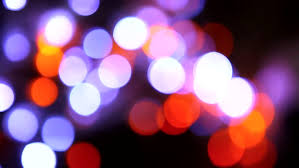 out of focus tree lights are blinking and on a
