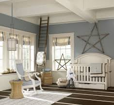 nursery rocker in traditional eanf with rustic accents next to