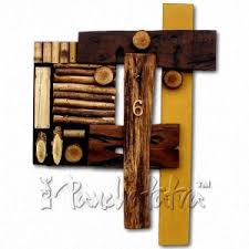 buy designer wall clock made using wooden pieces in india