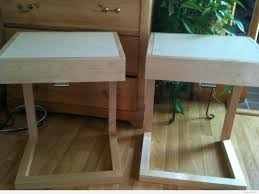 double ivory wooden c shaped nightstand with square white top on