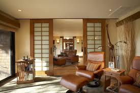 Dividing Doors Living Room by Cornwall Room Divider Doors Living Beach Style With Logs