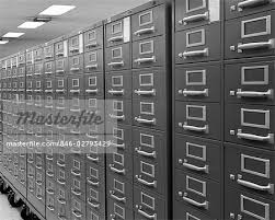 index card file cabinet 1970s angled view of series of index card file cabinets on wheels