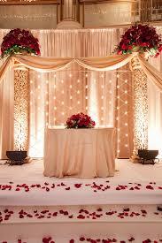 elegant cream decor with beautiful romantic red roses indian