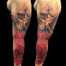 skull and rose tattoos by sebastian nowacki