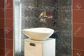contemporary bathroom design with broken mirror wall stock photo