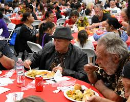 photos needy receive thanksgiving meal daily news