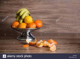 bowl of fruits close up of fruit bowl of orange and banana on table munich stock