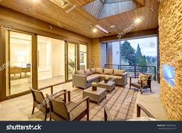 dreamy outdoor covered patio stone fireplace stock photo 704907478