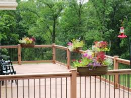 wooden deck with post lights and planter box outdoor deck