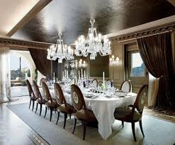 contemporary glamour large dining room with wall sconces and