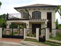 stylish facade of two storey house with iron fences part of