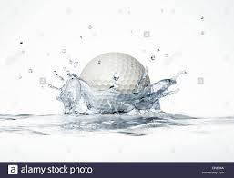 white golf ball splashing into water forming a crown splash on