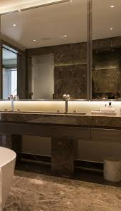 346 best bathrooms images on pinterest bathroom ideas room and marble clad glamorous bathroom with bronze pvd stainless steel framed mirrors