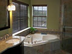 corner tub bathroom ideas master bath with granite countertops stand up shower with a shelf