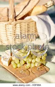 Wine Picnic Baskets Picnic Basket With Champagne Wine Cheese And Fruit Stock Photo