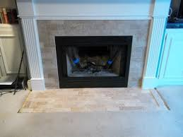 like the idea of brick or stone inlay within the border of the fireplace