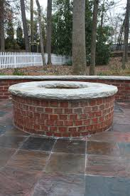 red brick firepit with stone cap fireplaces and firepits