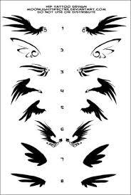calvin klein small wing tattoos