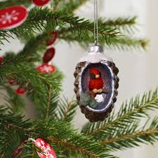 a world within pinecone with cardinal mini ornament keepsake
