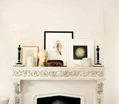 mantel decor with candle holders and framed art and ceramic vase