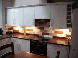 white stone tile backsplash smooth black wooden counter plain