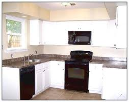 kitchens with white cabinets and black appliances white cabinets black appliances beautiful tourism
