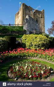 flowers in ornamental beds decorate guildford castle stock