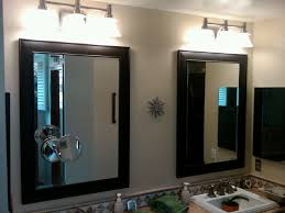 contemporary bathroom with bathroom vanity light fixtures and 3