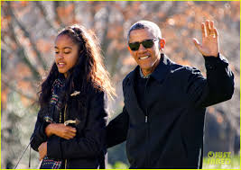 president obama family arrive home from vacation photo