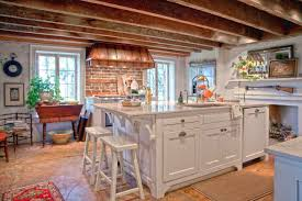 decorating farmhouse kitchen with brick backsplash and copper