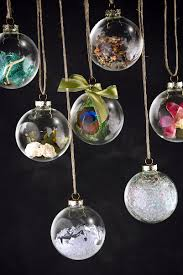 create your own unique christmas ornaments by filling clear glass