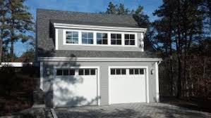 cape garage with living space above custom home builder