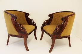 hollywood regency pair of tub arm chairs swan carved mahogany