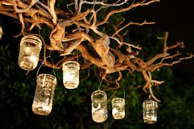 capture the light with a diy outdoor jar chandelier
