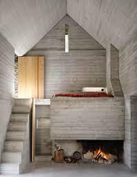 rustic swiss structure hides modern underground home urbanist