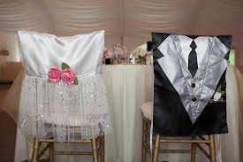 and groom chair covers how adorable are these chair covers for the sweetheart table