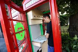 britain u0027s iconic red phone booths find their second calling