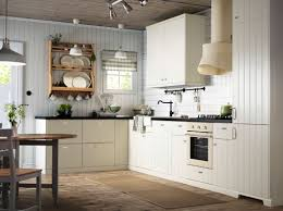 Kitchens With Off White Cabinets An Off White Country Kitchen With Black Worktops Combined With